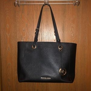 Gently used Michael Kors Black Tote with Pocket!!!